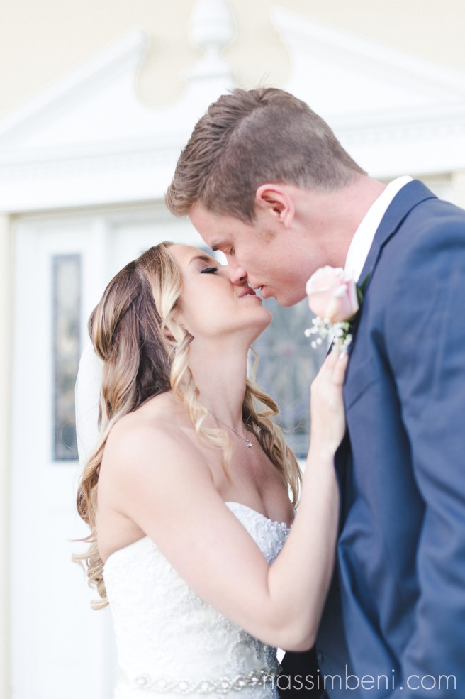 bride and groom kiss at wedding at Bellewood Plantation in Vero Beach Florida by Nassimbeni Photography