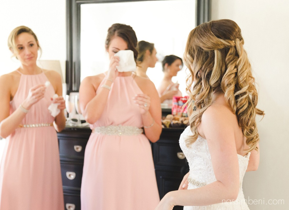 maid of honor and matron of honor wipe away tears as they see their best friends dress for the first time at Bellewood Plantation in Vero Beach Florida by Nassimbeni Photography