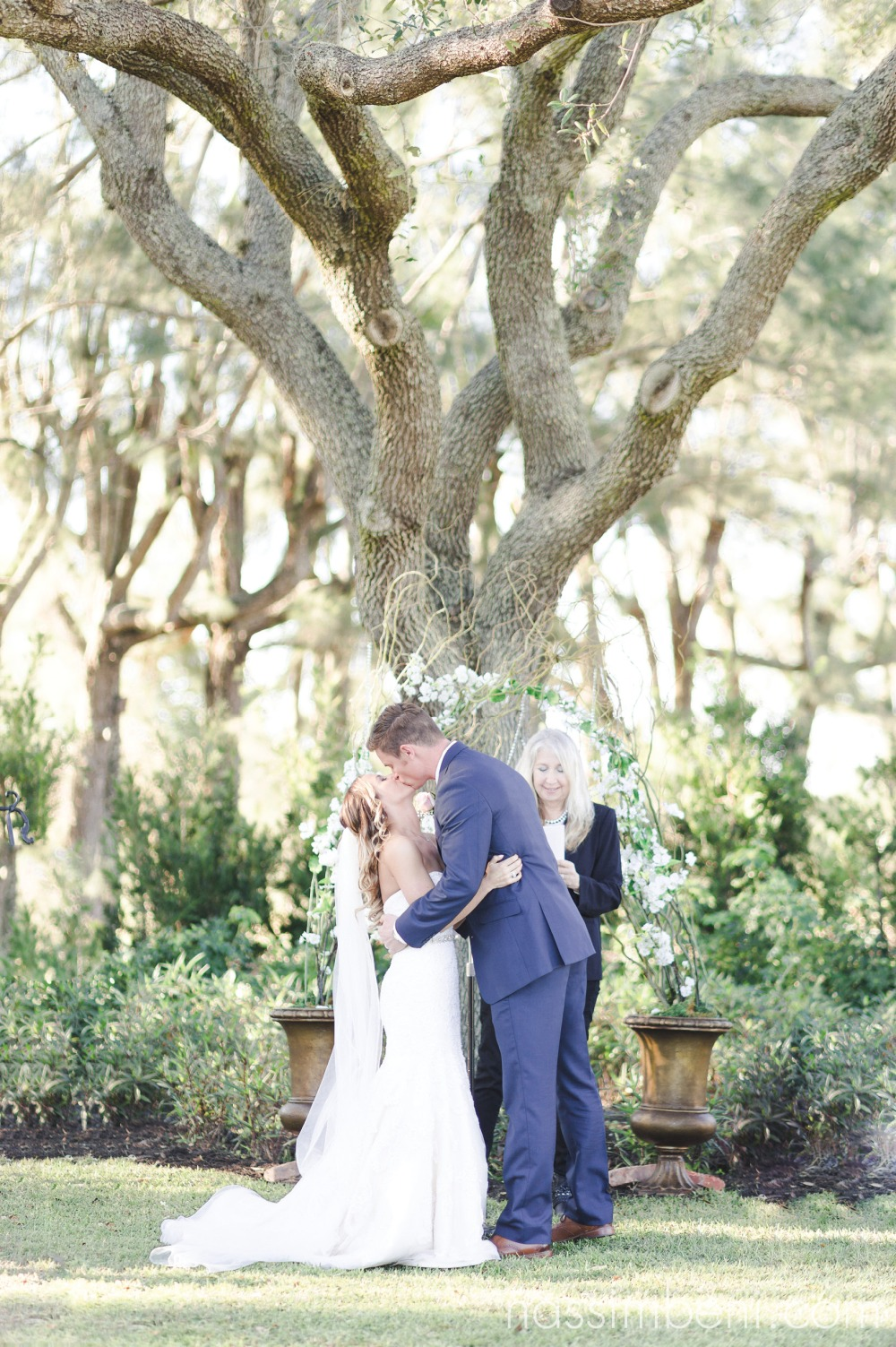 first kiss as husband and wife at Bellewood Plantation in Vero Beach Florida by Nassimbeni Photography