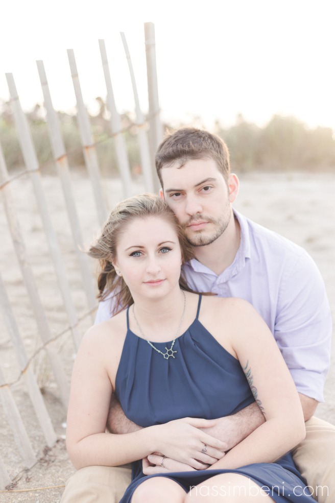 gentle gaze of engaged couple for beach photos in stuart florida in front of the house of refuge by nassimbeni photography