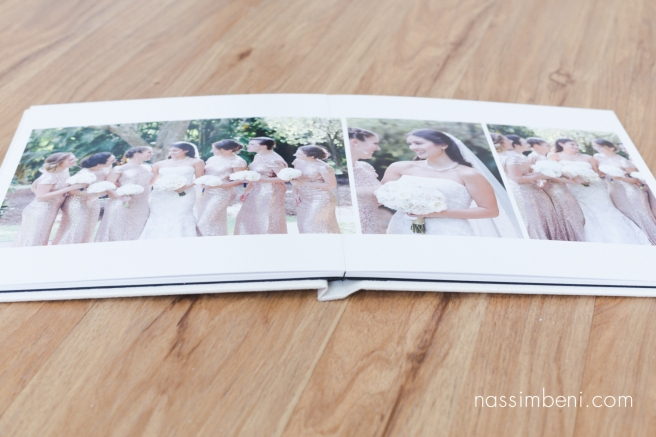 layflat album of Cassidy and Bryce heirloom album for Old city hall in Ft Pierce wedding by Nassimbeni Photography