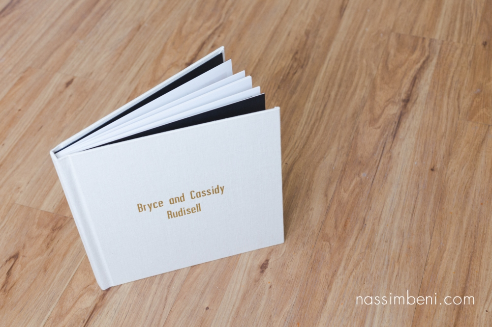 thick pages and linen cover for Cassidy and Bryce heirloom album for Old city hall in Ft Pierce wedding by Nassimbeni Photography
