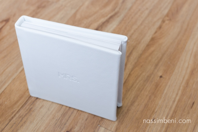 small 5x5 white leather album by nassimbeni Photography