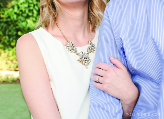 statement necklace and simply beautiful engagement ring by nassimbeni photography in front of worth avenue garden wall