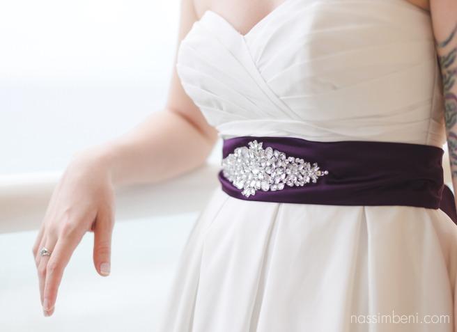 purple sash on strapless davids bridal dress by Nassimbeni Photography
