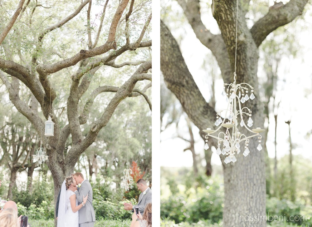 first kiss under large tree at bellewood plantation wedding ceremony by nassimbeni photography