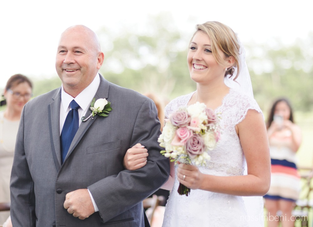 bride and dad walking down aisle by nassimbeni photography