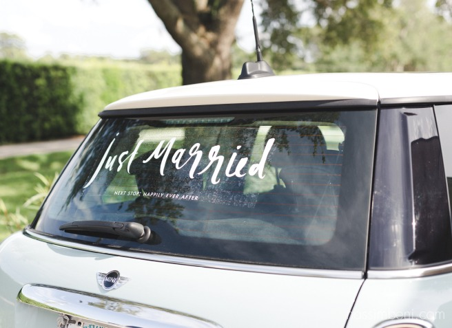 kate spade just married car sticker on baby blue mini cooper getaway car at bellewood plantation wedding by nassimbeni photography