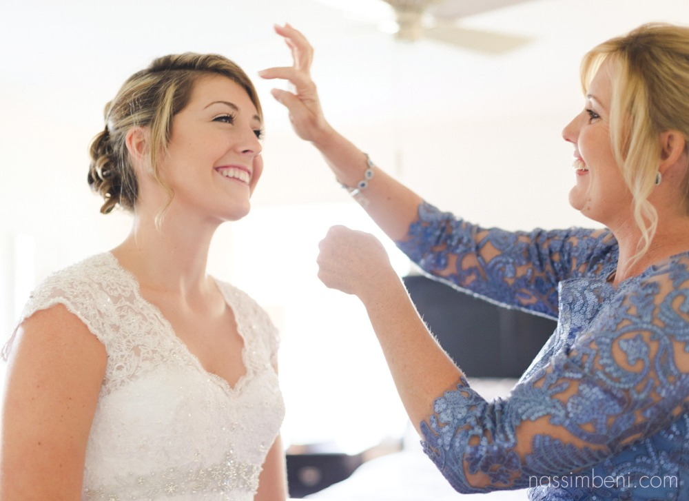 mom adjusts brides hair while at bellewood wedding venue in florida by nassimbeni photography