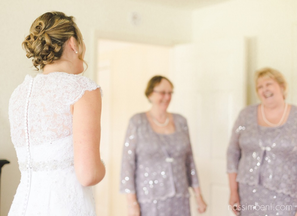 first look with both grandmothers at bellewood plantation wedding venue in vero beach florida by nassimbeni photography