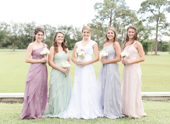 multi colored bridesmaids at bellewood plantation wedding venue by nassimbeni photography