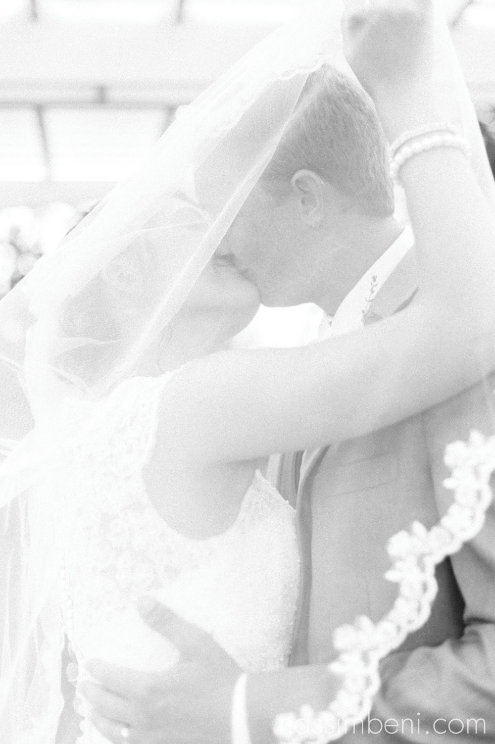 intimate bride and groom under veil for wedding by nassimbeni photography