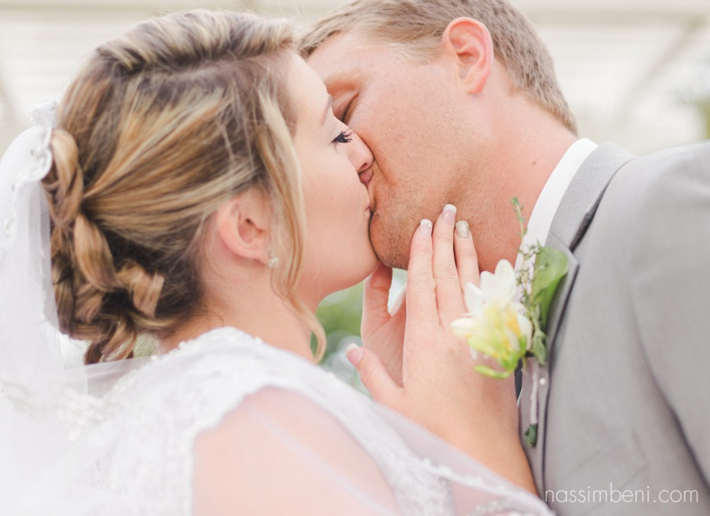 kiss from bride and groom at bellewood plantation wedding by nassimbeni photography