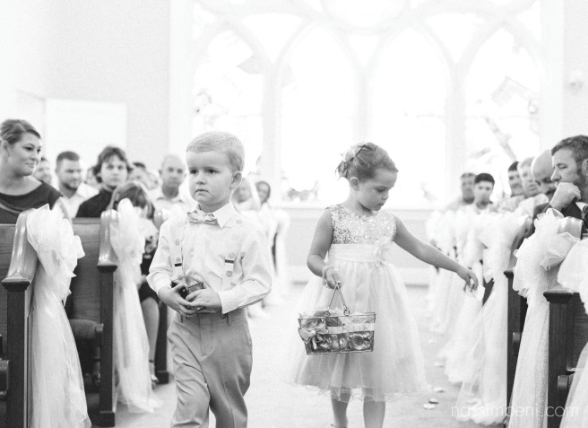 ring bearer and flower girl at first united methodist church wedding in okeechobee florida by nassimbeni photography