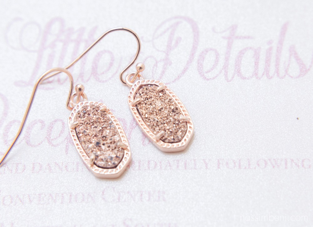 rose gold earrings on vintage wedding invitation suite by nassimbeni photography