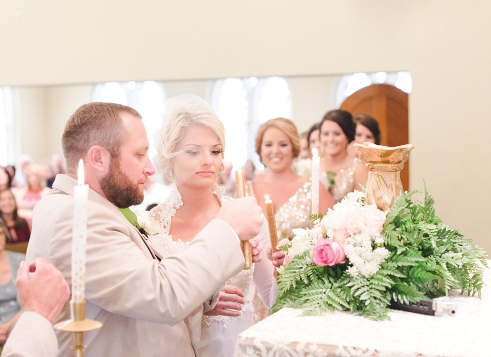 lighting of the candle ceremony at first united methodist church by nassimbeni photography