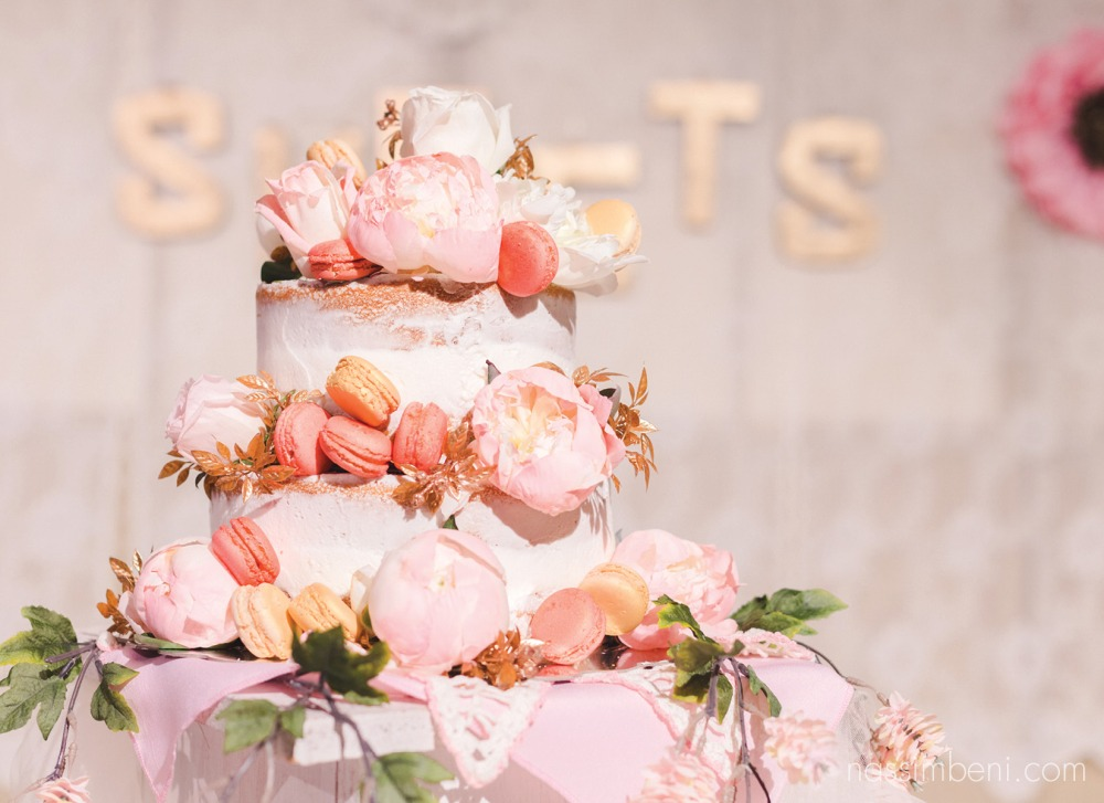 beautiful naked wedding cake with macaroons peonies and roses by nassimbeni photography