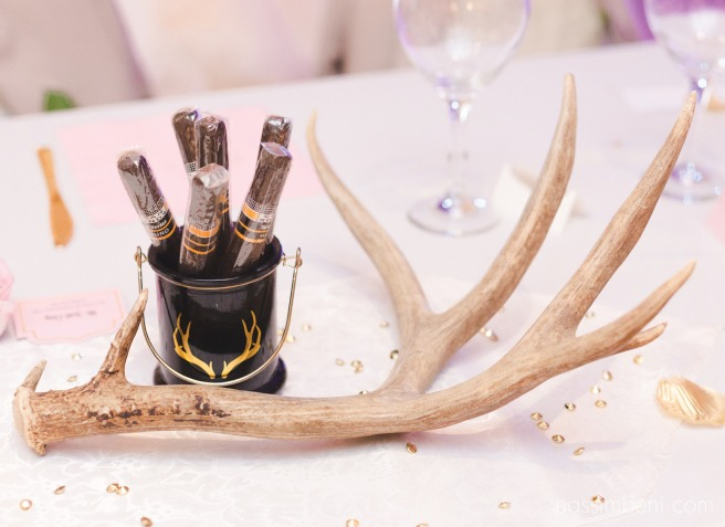 antlers and cigars at koa convention center wedding decor by nassimbeni photography
