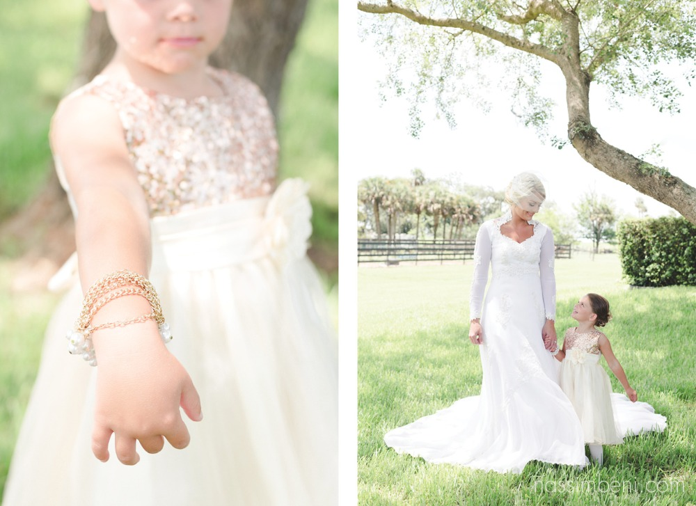 bride in vintage gown with flower girl in sequin dress v