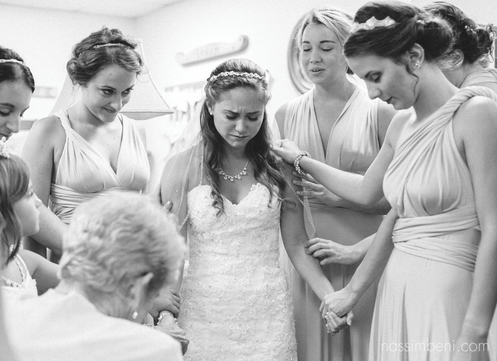 prayer before the wedding at first baptist church of melbourne wedding by nassimbeni photography