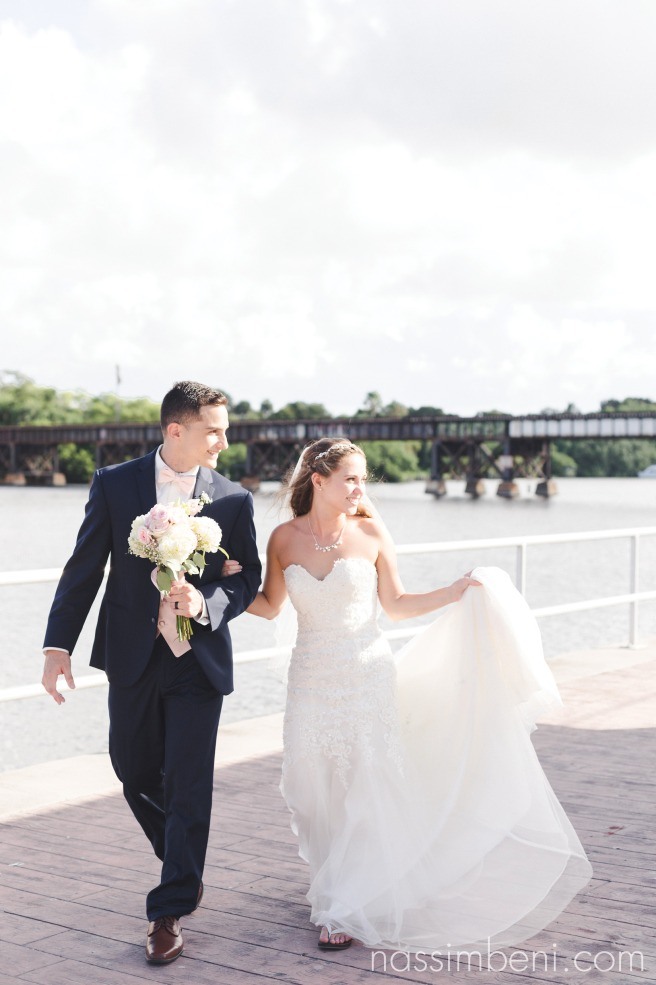 bride and groom infant of more love train bridge at crane creek promenade park by nasimbeni photography