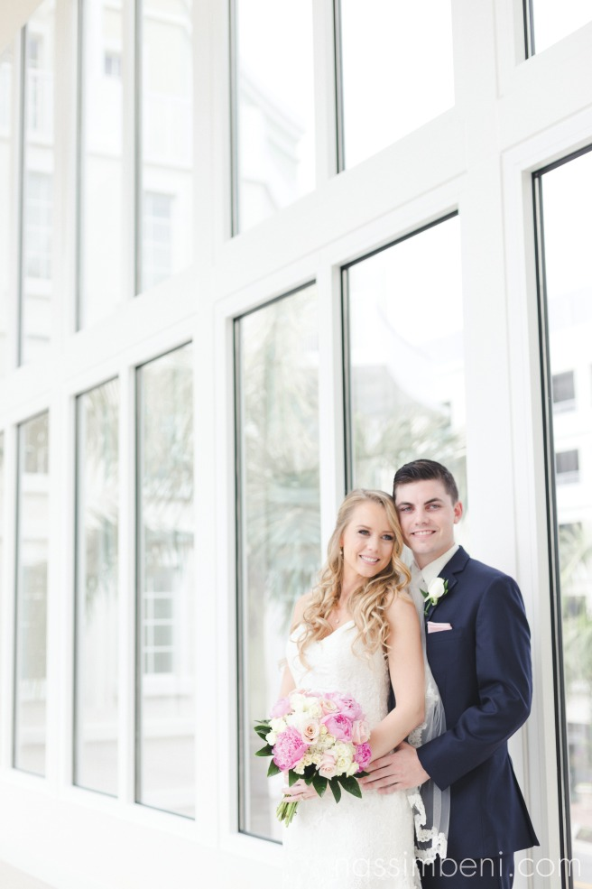 glass bridge at the wyndham grand in jupiter florida bride and groom after their first look by nassimbeni photography