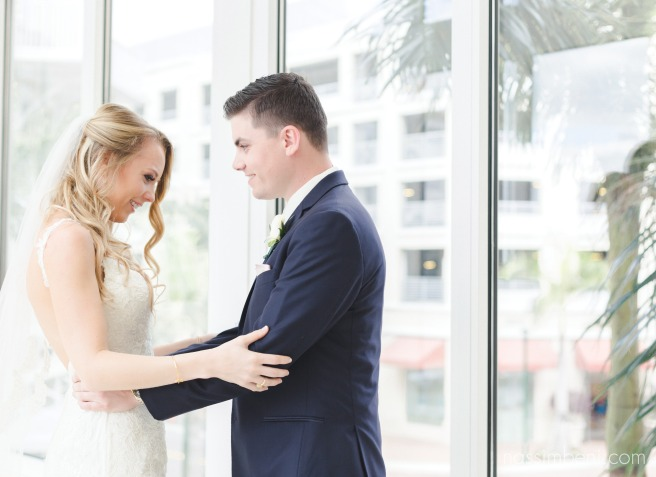 first look between bride and groom at wyndham grand in jupiter florida by nassimbeni photography