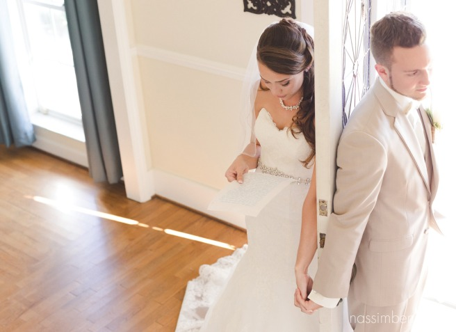 bellewood plantation bride and groom read notes to each other with the door in between by Nassimbeni Photography