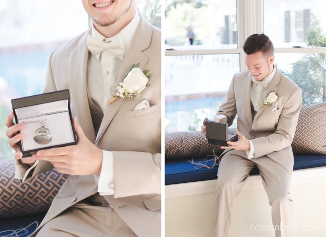 groom opens gift from bride at bellewood plantation shot by sabrina henley of s&s henley photography