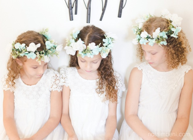 tree flower girls in tiffany blue flower crowns side by side on bellewood plantation seat by Nassimbeni Photography