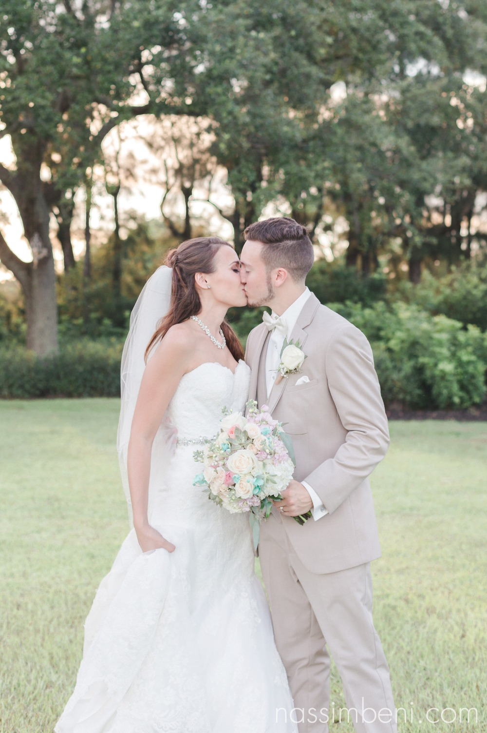 bride and groom kiss at bellewood plantation wedding venue by Nassimbeni Photography
