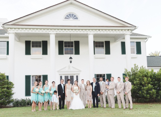 bride and grooms families in front of bellewood plantation by Nassimbeni Photography