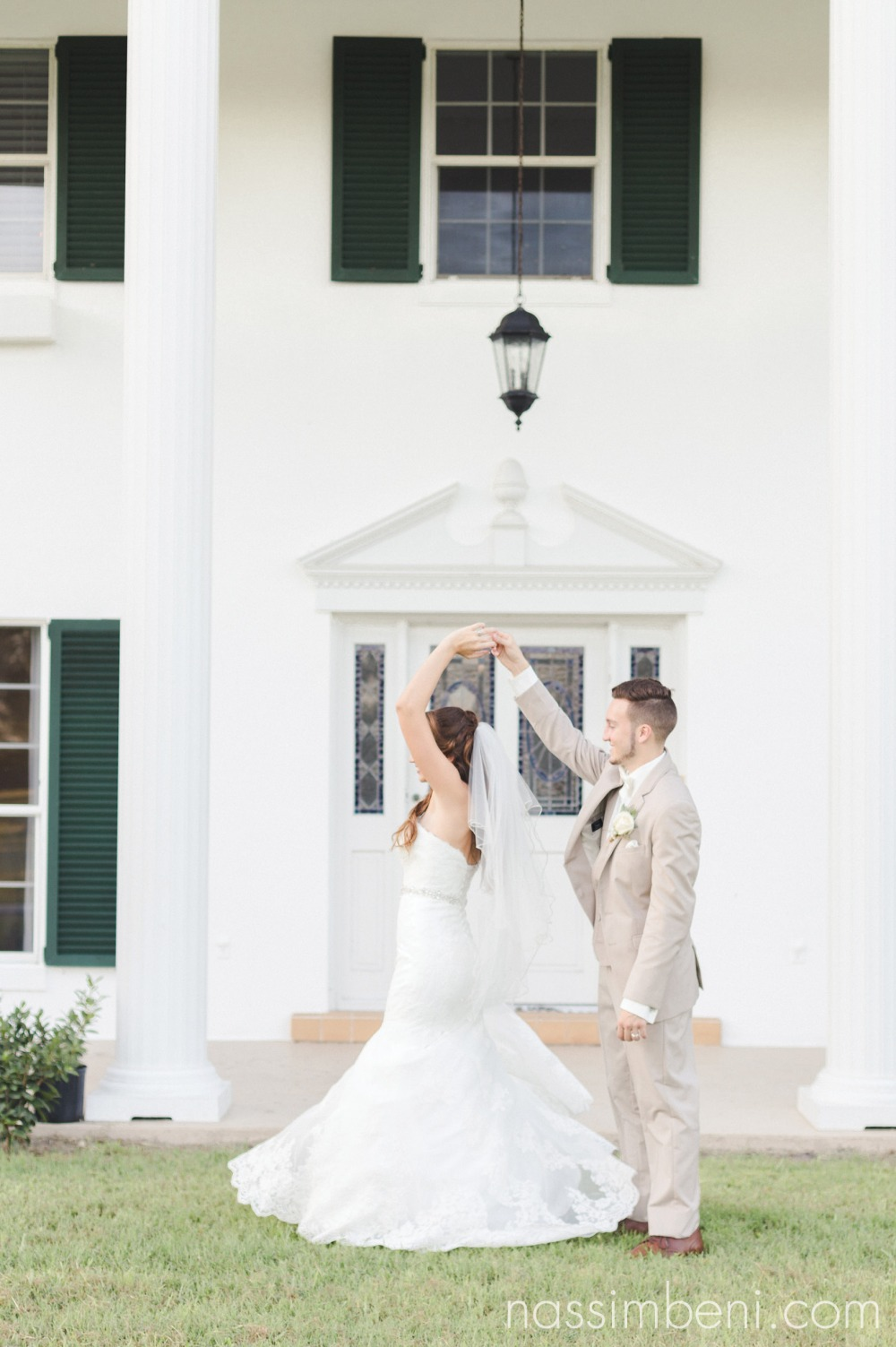 bride twirls in front of bellewood plantation by Nassimbeni Photography