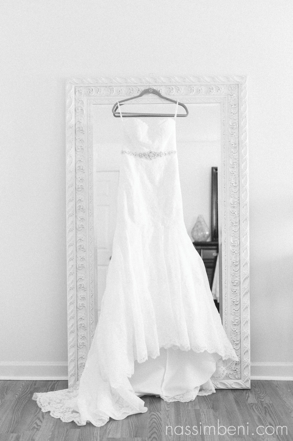 brides wedding dress on white mirror at bellewood plantation by Nassimbeni Photography
