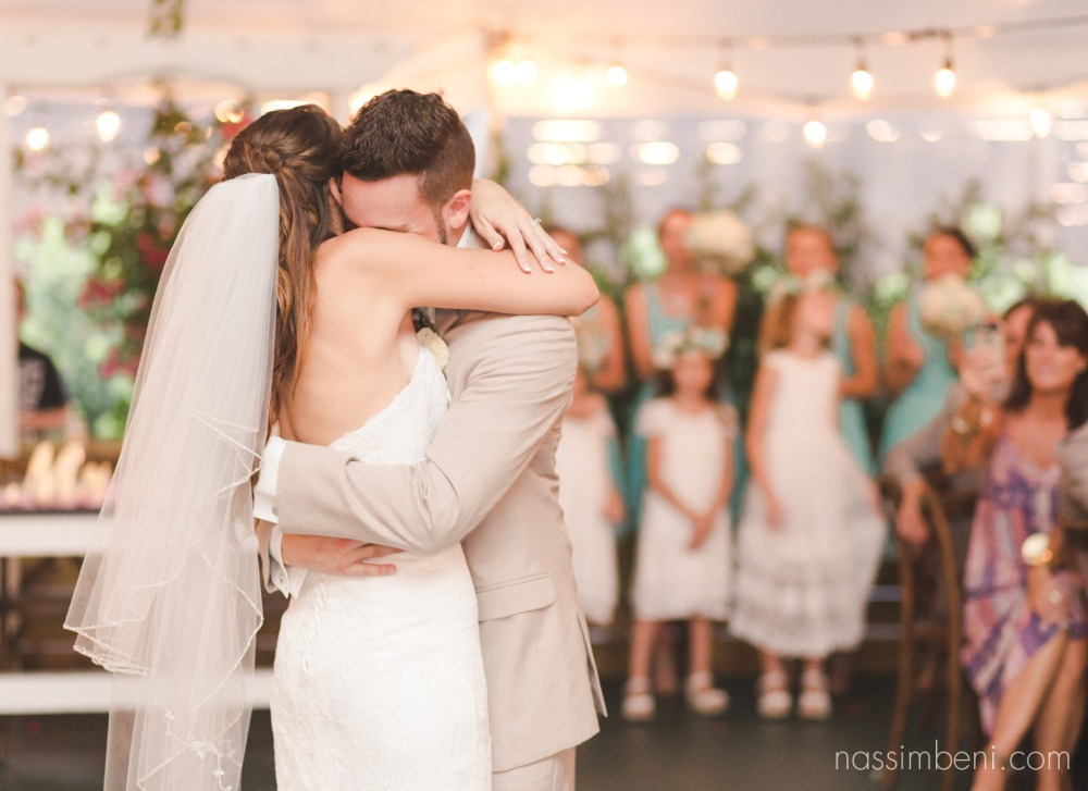 bride and groom embrace at bellewood plantation wedding by Nassimbeni Photography