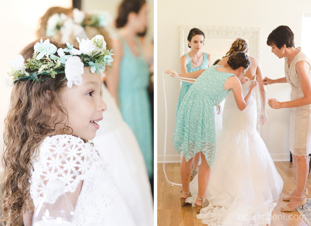 flower girl admiring bride in her wedding gown while siblings and mother of the bride help her into it at bellewood plantation by Nassimbeni Photography