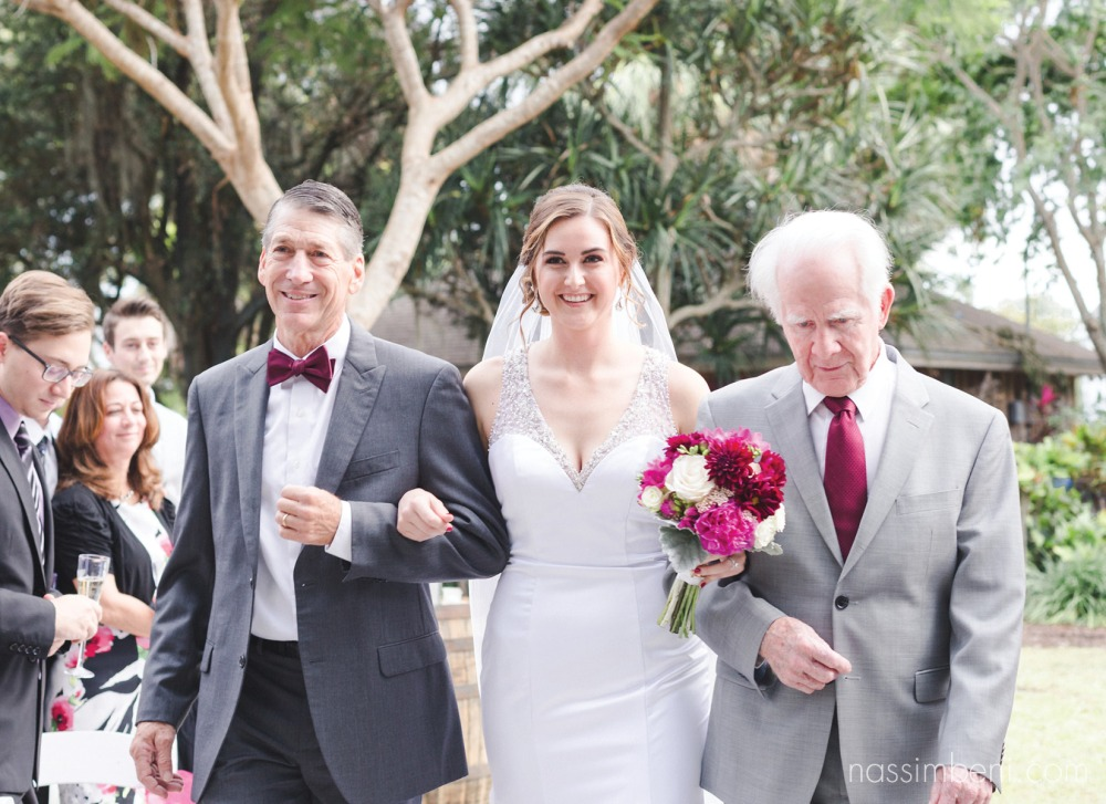 bride walked down aisle by dad and grandpa at heathcote botanical garden