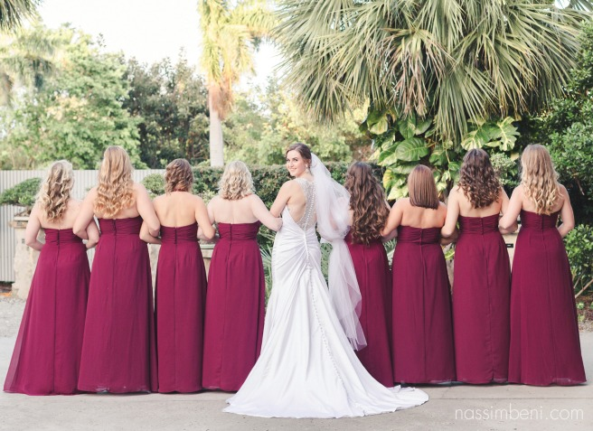 back of brides dress with bridesmaids at heathcote botanical garden by vero beach wedding photographer Nassimbeni Photography