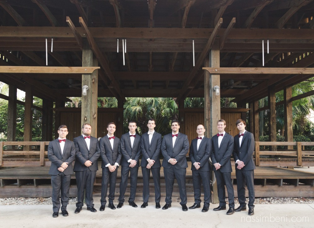 groomsmen at wooden structure in heathcote botanical garden by Nassimbeni Photography