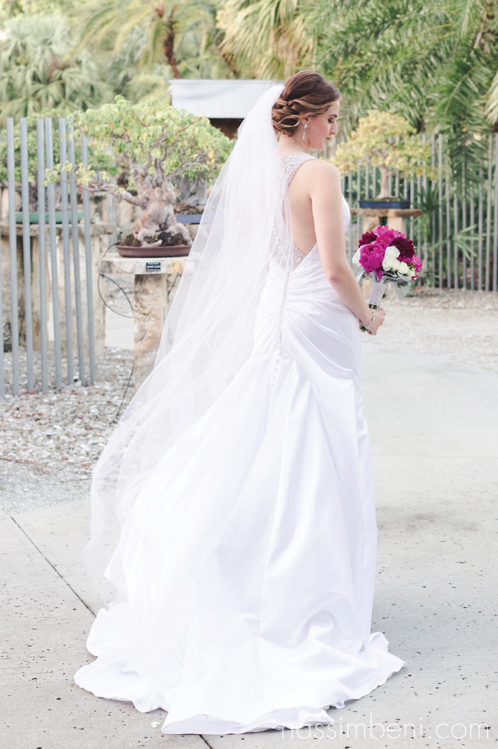 wind blowing in brides gown from minervas bridal
