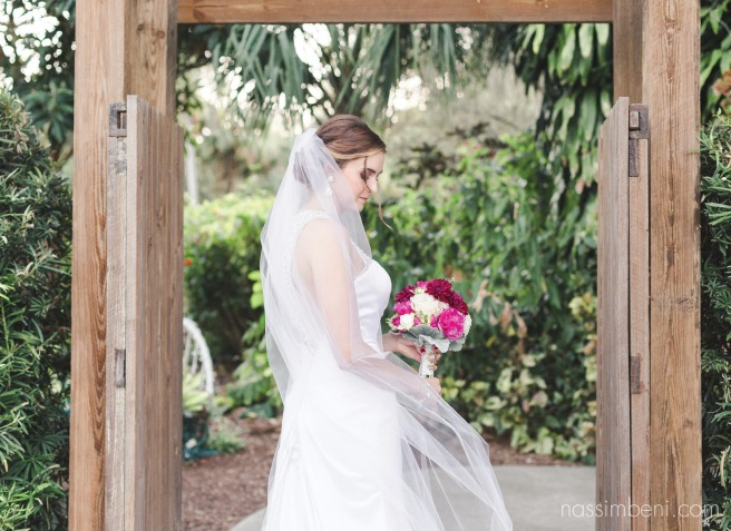 beautiful bride under wooden walk way at heathcote botanical garden by Nassimbeni Photography
