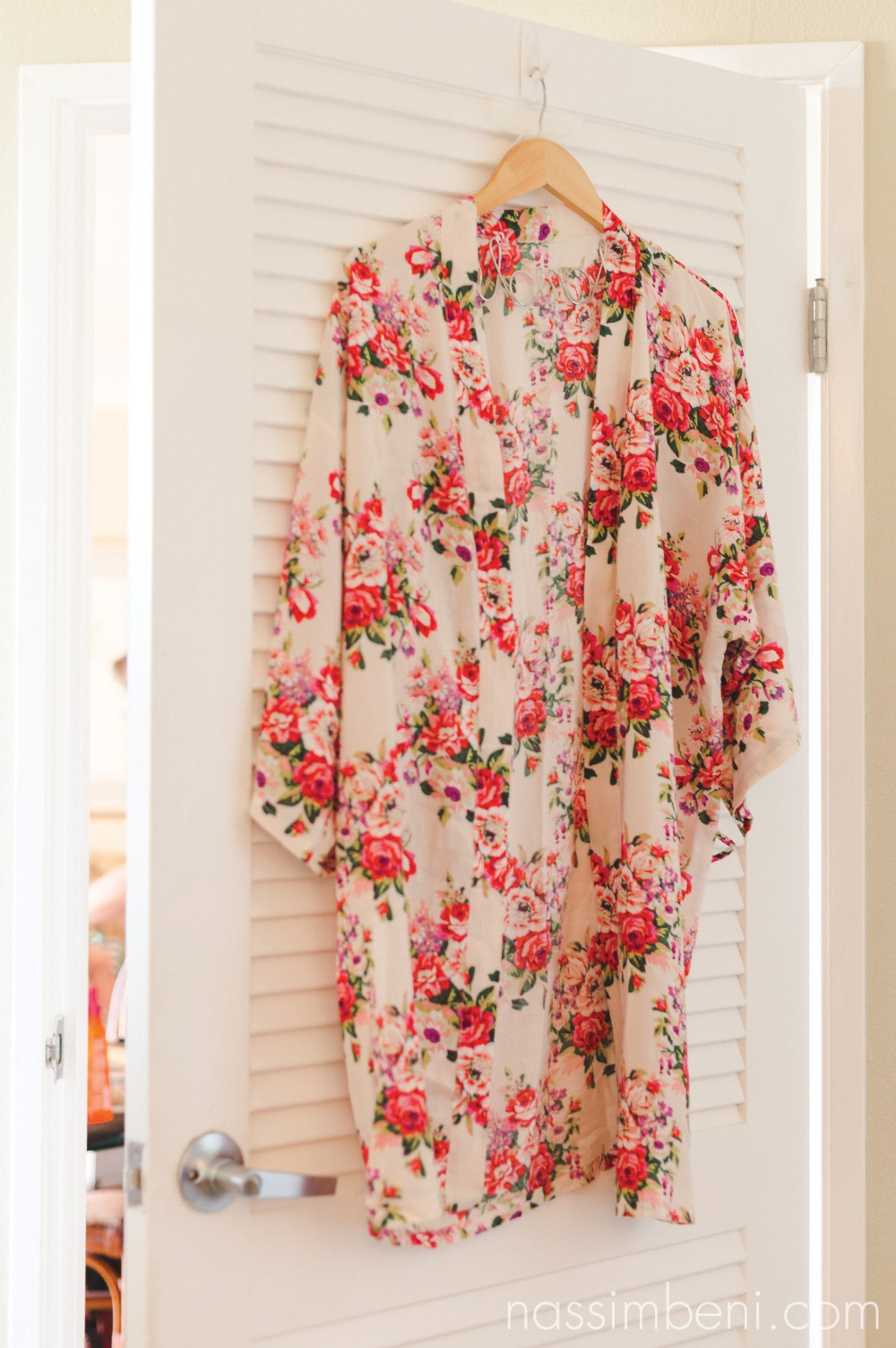 brides floral robe on door at palm beach shores resort by nassimbeni photography