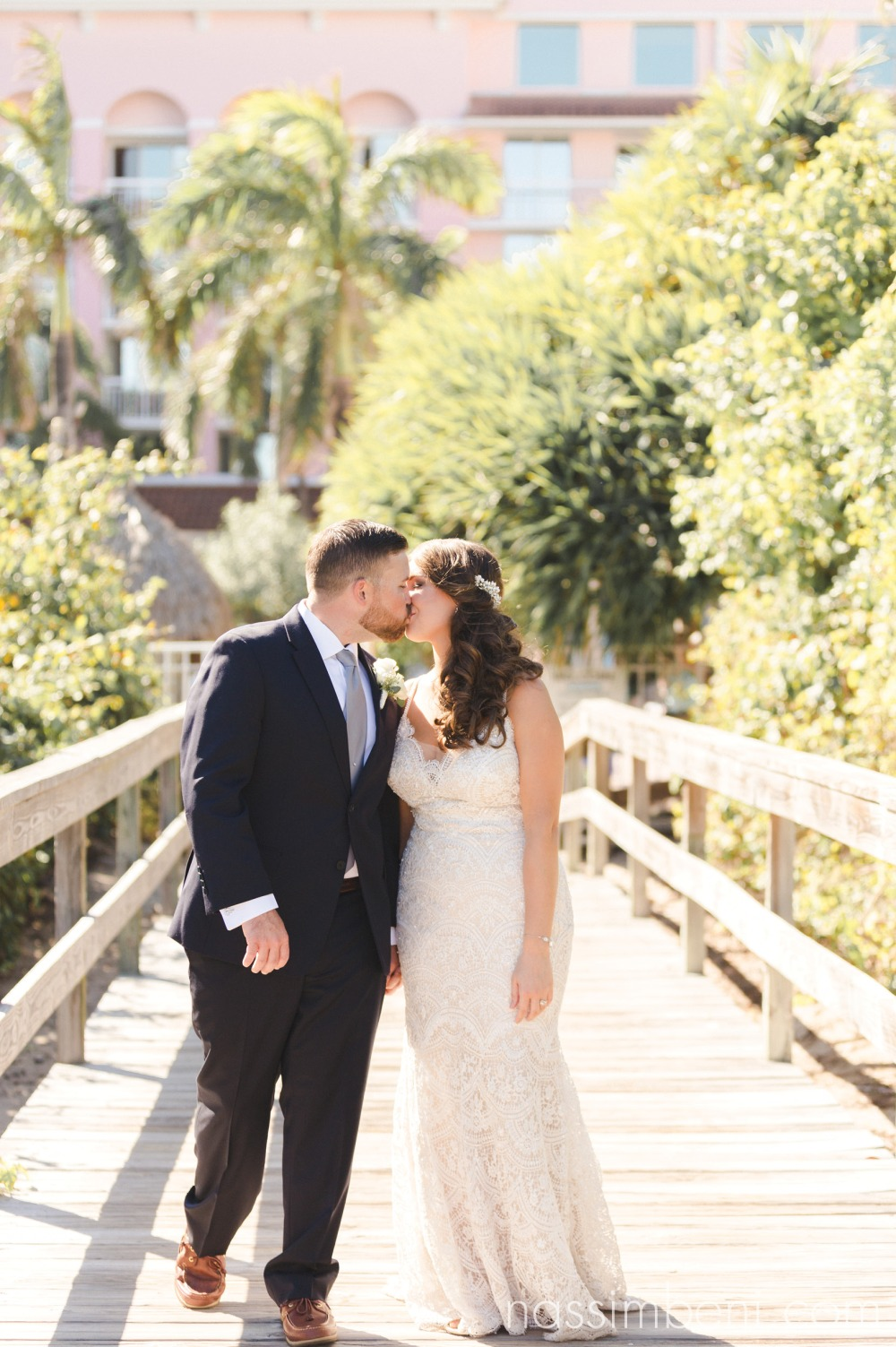 bride and groom coastal palm beach shores wedding by nassimbeni photography