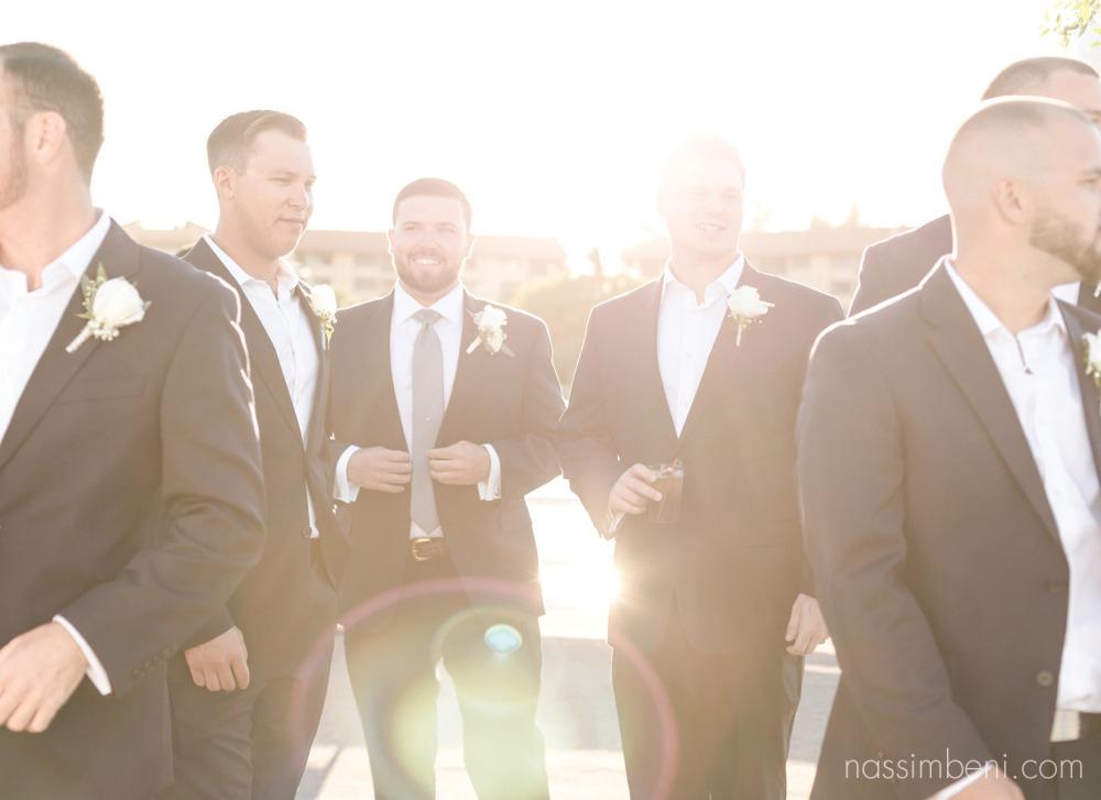 backlit groomsmen on catalina yacht wedding by nassimbeni photography