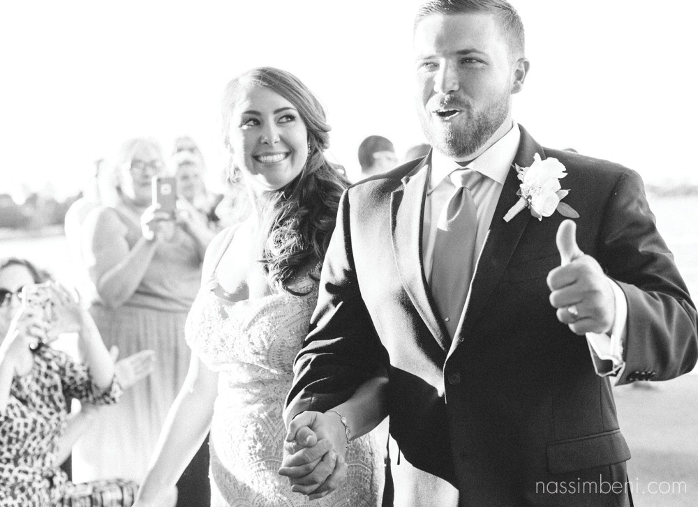 excited mr and mrs on the catalina yacht wedding by nassimbeni photography