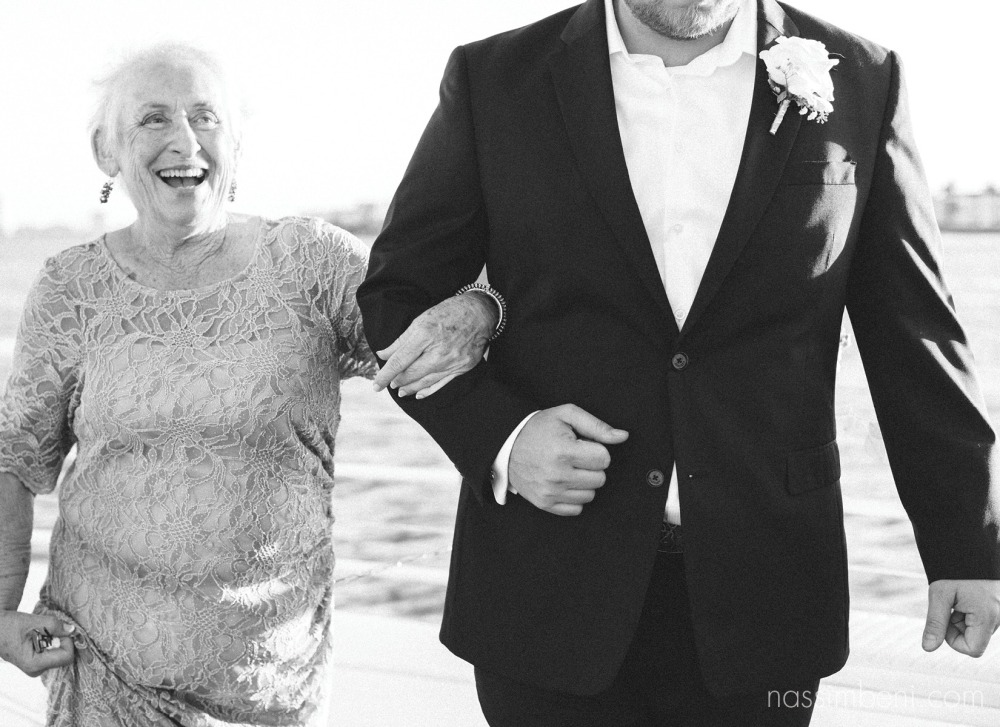 grandma being escorted by groomsmen by nassimbeni photography