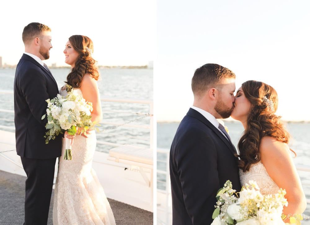 bride and groom kissing at sunset yacht wedding in palm beach florida by nassimbeni photography