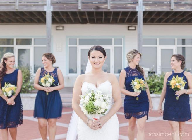 navy blue mismatched bridesmaids at indian riverside park wedding by treasure coast wedding photographer nassimbeni photography