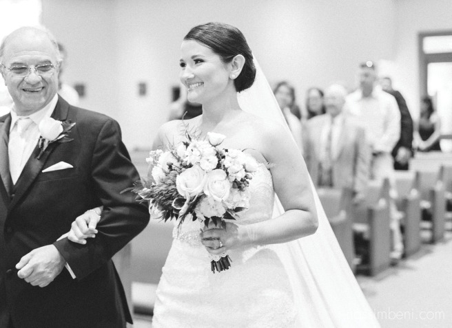 bride walks in at holy family catholic church by port st lucie wedding photographer nassimbeni photographer
