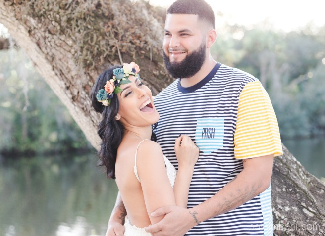 laughing couple at sunset for white city park engagement
